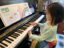 Beginner student Linh wears her rainbow skirt on the day she plays the rainbow piece!